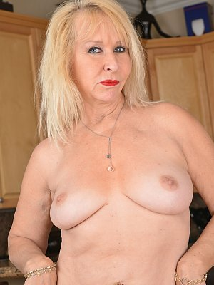 Mature Housewife Posing in the Kitchen
