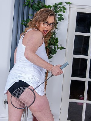 Cougar playing with her racket and her pussy